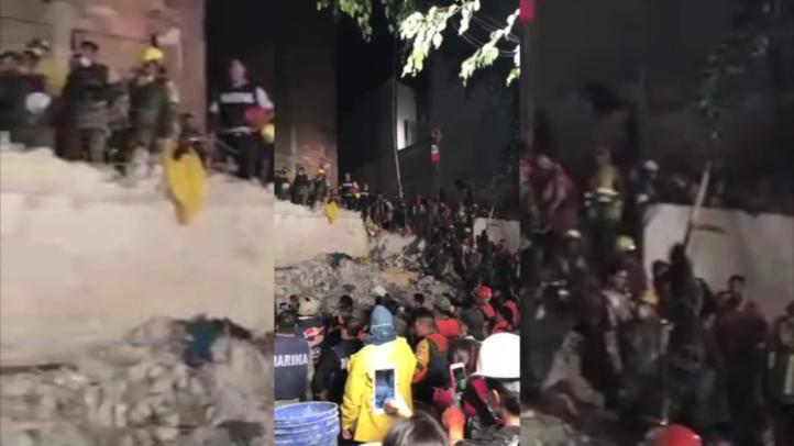 Cantan Himno Nacional luego de sacar último cuerpo de escombros