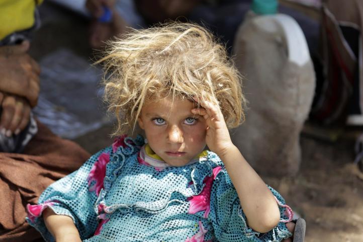 Irak: cientos de yazidis logran llegar a un campamento de refugiados