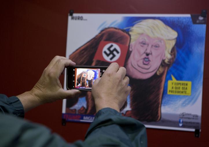Caricaturistas crean un muro de arte contra Trump